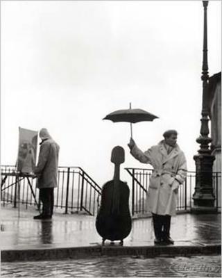 Ein Musiker im Regen Kunstdruck Robert Doisneau
